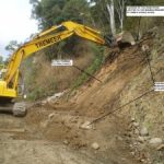 Ch 1260 – Excavator trimming upslope area & removing floating boulders