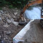 Ch 1325 placing rock at abutment to stormwater entrance at culvert crossing