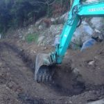Ch 420 construction of a reinforeced concrete drain and small wall to stabilise rocky outcrop