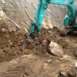 Ch 820 digging of V-drain against upslope