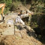 Construction of armour rock fill embankment